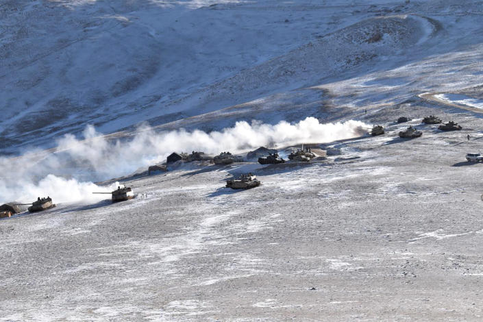 FILE - In this Feb. 10, 2021, file photo provided by the Indian Army, tanks pull back from the banks of Pangong Tso lake region, in Ladakh along the India-China border. The foreign ministers of India and China have met in Tajikistan, Wednesday, July 14, 2021 with New Delhi stressing that a military standoff along a mountainous border area is profoundly disturbing their ties, and warning that any unilateral change in the status quo by Beijing is unacceptable. Indian External Affairs Minister S. Jaishankar said in a tweet that a full restoration and maintenance of peace and tranquility in border areas is essential for the development of bilateral ties. (Indian Army via AP, File)