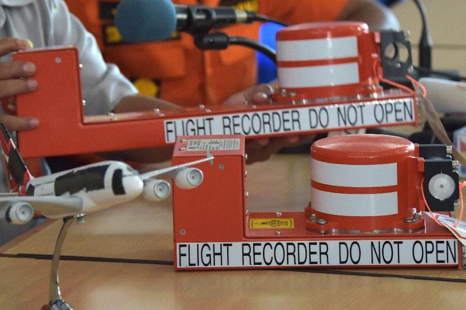 Despite the name, the two boxes -- consisting of the flight data recorder and the cockpit voice recorder -- are in fact bright orange (AFP Photo/Adek Berry)
