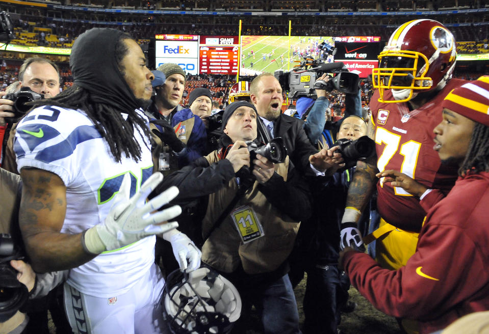 Niners cornerback Richard Sherman (25) and new left tackle Trent Williams had a heated exchange in a playoff game seven years ago. Now they're teammates. (Mark Gail/Tribune News Service via Getty Images)