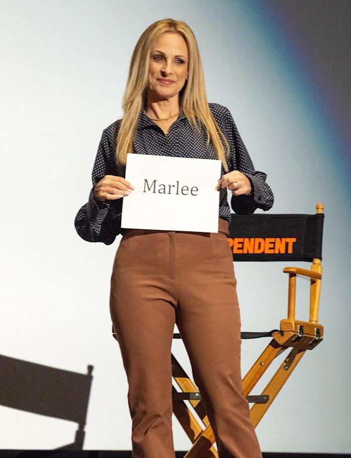 <p>Marlee Matlin holds up a sign with her name on it at the Film Independent Special Screening of <i>CODA</i> at Harmony Gold on Sept. 14 in L.A. </p>