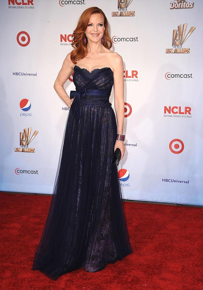 "Marcia Cross gave her ""Desperate Housewives"" co-star a run for her money at the ALMAs by perfectly pairing a lacy, bow-adorned Jean Fares Couture gown with a bedazzled cuff, Swarovski crystal-encrusted clutch, and enchanting earrings. Steve Granitz/<a href=""http://www.wireimage.com"" target=""new"">WireImage.com</a> - September 10, 2011"
