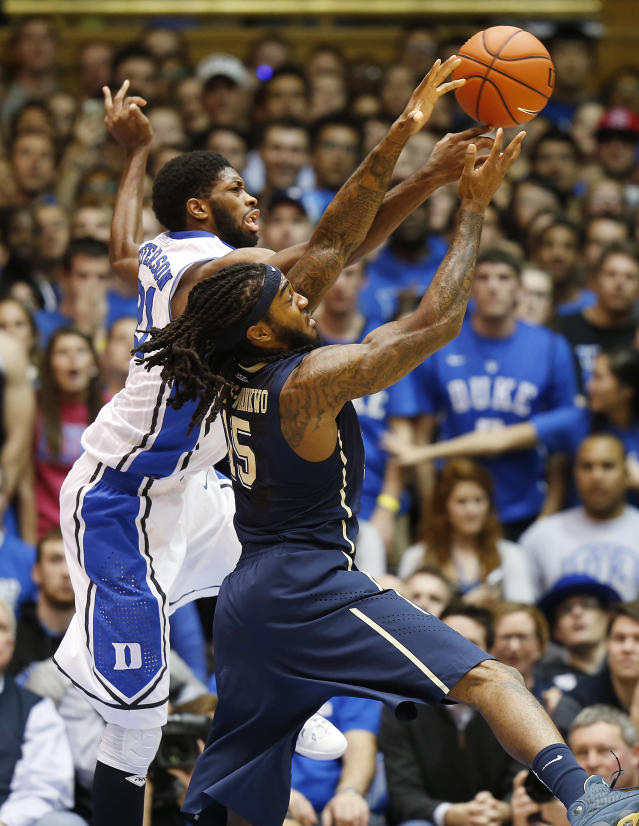 FILE- In this Jan. 19, 2015, file photo, Duke's Amile Jefferson, left, battles Pittsburgh's Aron Phillips-Nwankwo for the ball during the first half of an NCAA college basketball game in Durham, N.C. Phillips-Nwankwo has last five years living a double life at Pittsburgh. On the basketball court the 6-foot-7 forward is an end of the bench academic walk-on whose biggest impact is made in practice. In the classroom he's a budding superstar who overcame the loss of his mother and a crisis of confidence to emerge with two degrees and an eye toward medical school. (AP Photo/Ellen Ozier, File)