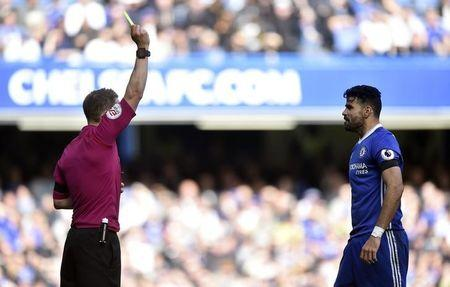 Britain Soccer Football - Chelsea v Crystal Palace - Premier League - Stamford Bridge - 1/4/17 Chelsea's Diego Costa is shown a yellow card by referee Craig Pawson Reuters / Hannah McKay Livepic