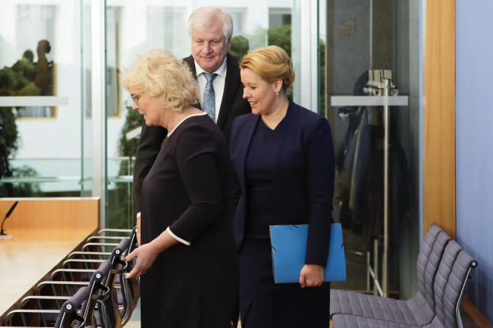 German Interior Minister Horst Seehofer, center, German Justice Minister Christine Lambrecht, left, and German Minister for Family Affairs, Senior Citizens, Women and Youth, Franziska Giffey, right, arrive for a news conference in Berlin, Wednesday, Oct. 30, 2019 on a package of measures against far-right extremism and anti-Semitism. Chancellor Angela Merkel's Cabinet signed off Wednesday on the tightening of gun laws, stricter persecution of hate crime online, and more financial support for initiatives fighting anti-Semitism and far-right extremism. (AP Photo/Markus Schreiber)