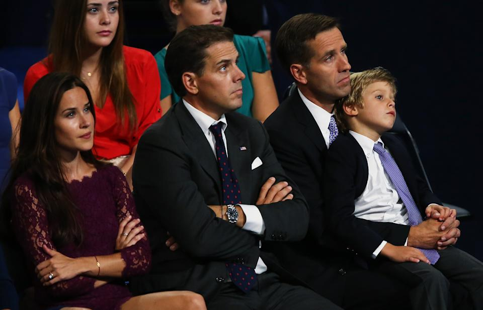 Ashley, Hunter and Beau Biden look onstage while seated among other people