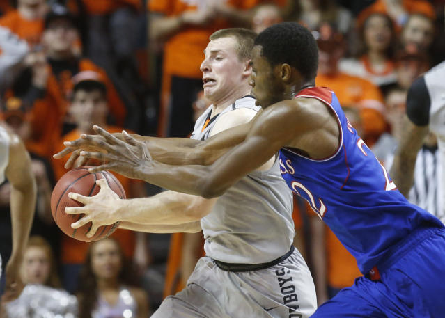 Oklahoma State guard Phil Forte (13) steals a pass intended for Kansas guard Andrew Wiggins (22) in the second half of an NCAA college basketball game in Stillwater, Okla., Saturday, March 1, 2014. Oklahoma State won 72-65. (AP Photo/Sue Ogrocki)