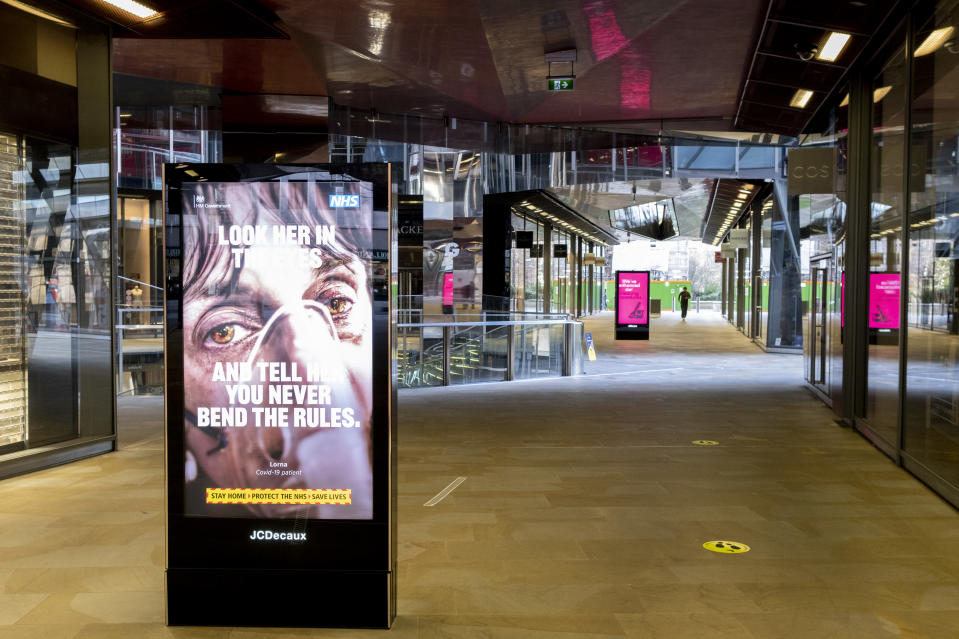 An advertisement showing a COVID patient in hospital urges the public to stay within lockdown rules, in an empty shopping mall in London, England. Photo: Richard Baker/In Pictures via Getty Images