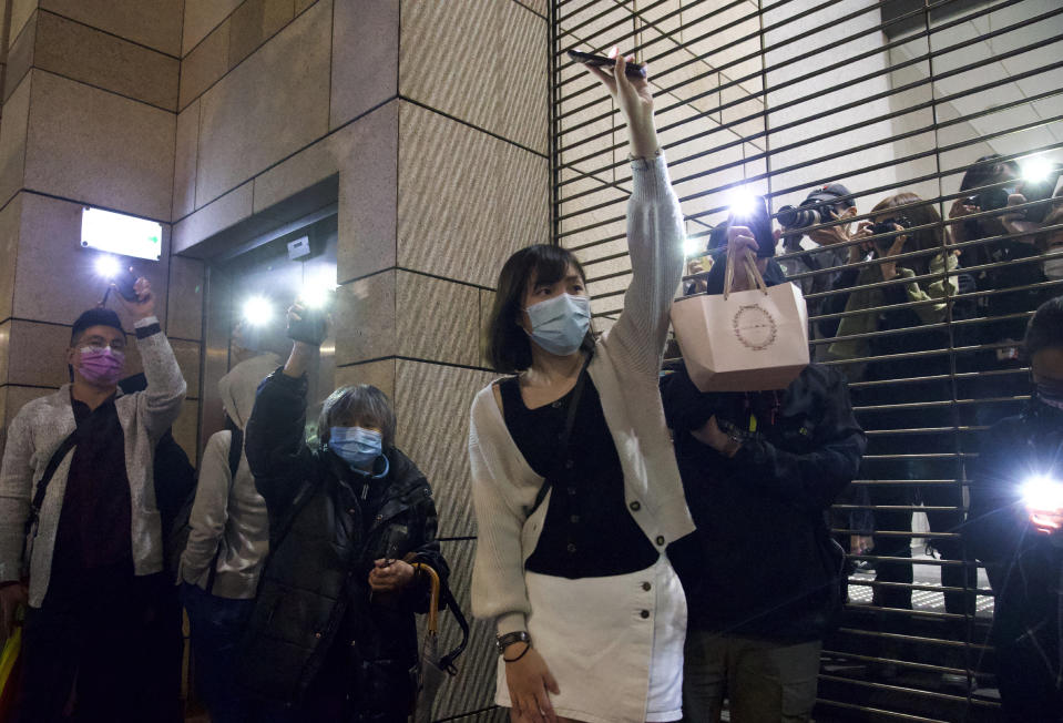 Supporters hold mobile phone lights outside a court in Hong Kong, Thursday, March 4, 2021. A marathon court hearing for 47 pro-democracy activists in Hong Kong charged with conspiracy to commit subversion enters its fourth day on Thursday, as the court deliberates over whether the defendants will be granted bail. (AP Photo/Vincent Yu)