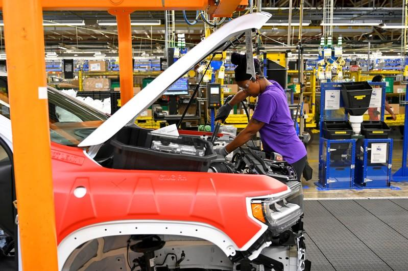 FILE PHOTO: Components are installed around the engine on the assembly line at the General Motors (GM) manufacturing plant in Spring Hill