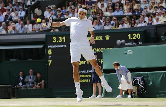 Roger Federer of Switzerland plays a return to Novak Djokovic of Serbia during the men's singles final at the All England Lawn Tennis Championships in Wimbledon, London, Sunday July 6, 2014. (AP Photo/Ben Curtis)