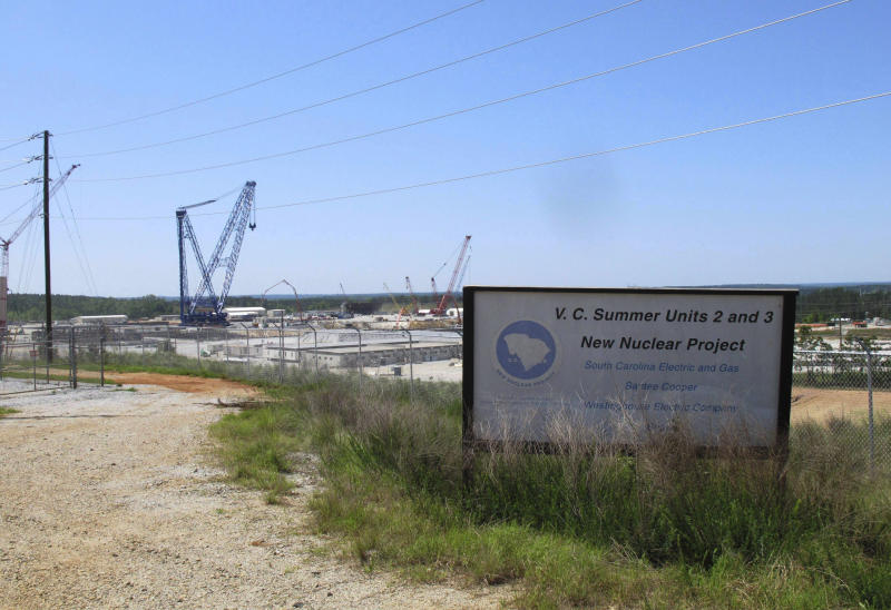 FILE - This April 9, 2012 file photo shows construction well underway for new nuclear reactors at the V.C. Summer Nuclear Station in Jenkinsville, S.C. South Carolina could pay off billions in debt and end uncertainty over lawsuits if it sells its state-owned utility, Santee Cooper, but the move would cost ratepayers more money over the next 20 years, state fiscal officials say in a report released Tuesday, Feb. 11, 2020. (AP Photo/Jeffrey Collins, File)