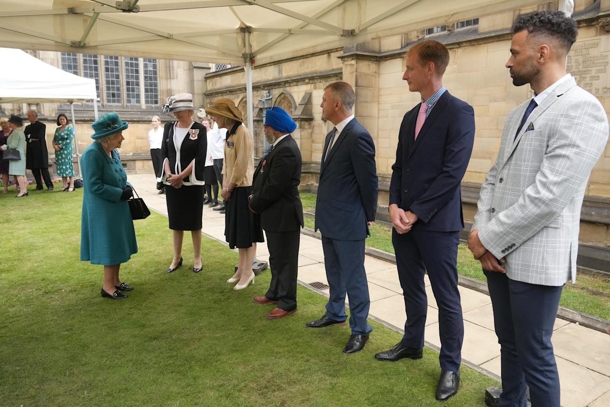 MANCHESTER, ENGLAND - JULY 08: Queen Elizabeth II meets guests during a visit to Manchester Cathedral on July 8, 2021 in Manchester, England. (Photo by Christopher Furlong/Getty Images)