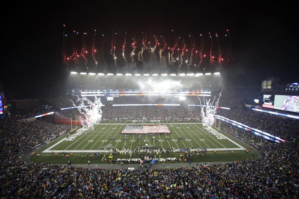 Fireworks soar over the American flag on the field before the AFC championship NFL football game between the New England Patriots and the Pittsburgh Steelers, Sunday, Jan. 22, 2017, in Foxborough, Mass. (AP)