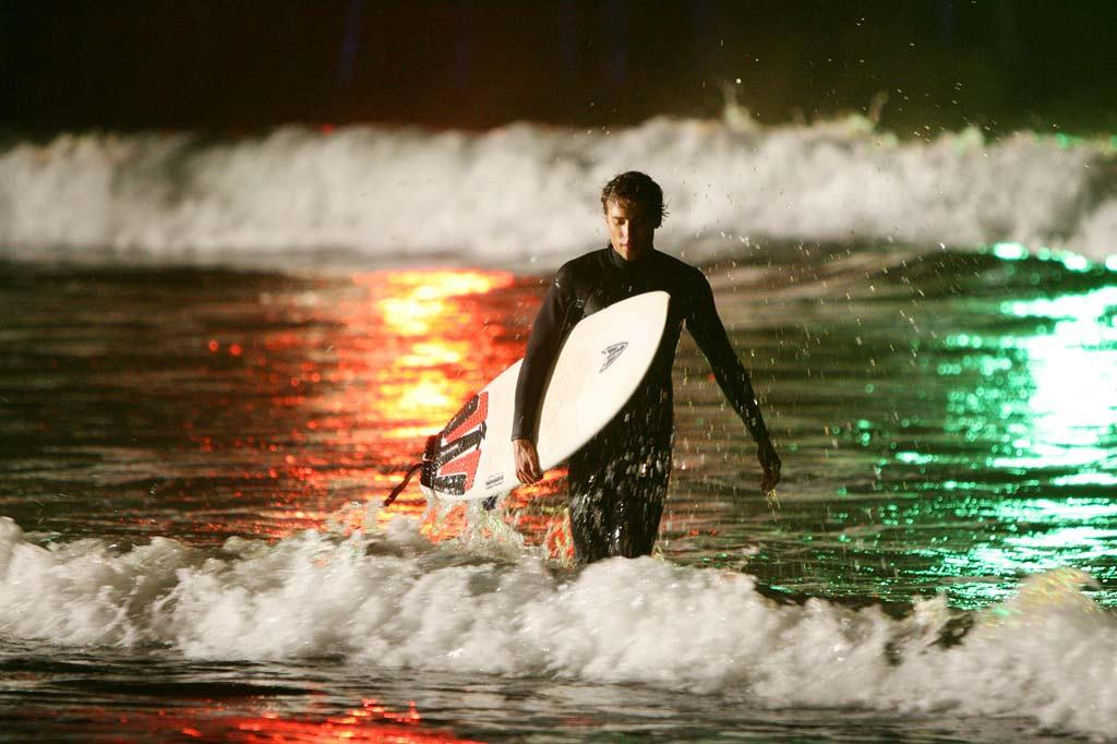 """Ethan Ward (<a href=""""/dustin-milligan/contributor/1272638"""">Dustin Milligan</a>) relieves stress by catching some waves near the Santa Monica Pier."""