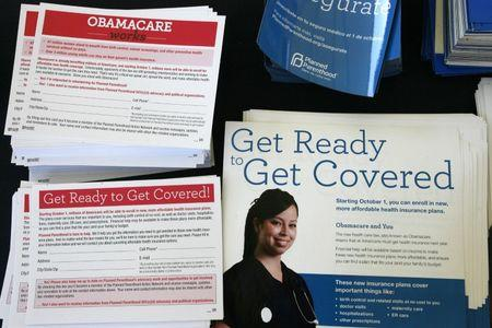 File photo: Information cards are stacked on a table during an Affordable Care Act outreach event for the Latino community in Los Angeles, California