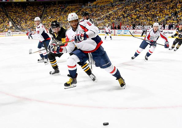 PITTSBURGH, PA - MAY 03: Alex Ovechkin #8 of the Washington Capitals handled the puck against Brian Dumoulin #8 of the Pittsburgh Penguins in Game Four of the Eastern Conference Second Round during the 2017 NHL Stanley Cup Playoffs at PPG Paints Arena on May 3, 2017 in Pittsburgh, Pennsylvania. (Photo by Joe Sargent/NHLI via Getty Images)