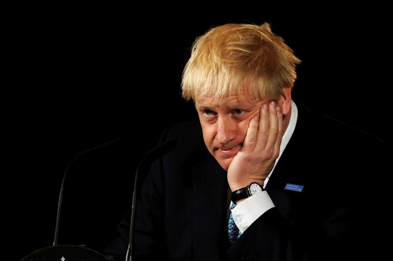 Britain's Prime Minister Boris Johnson reacts during a speech on domestic priorities at the Science and Industry Museum in Manchester Britain