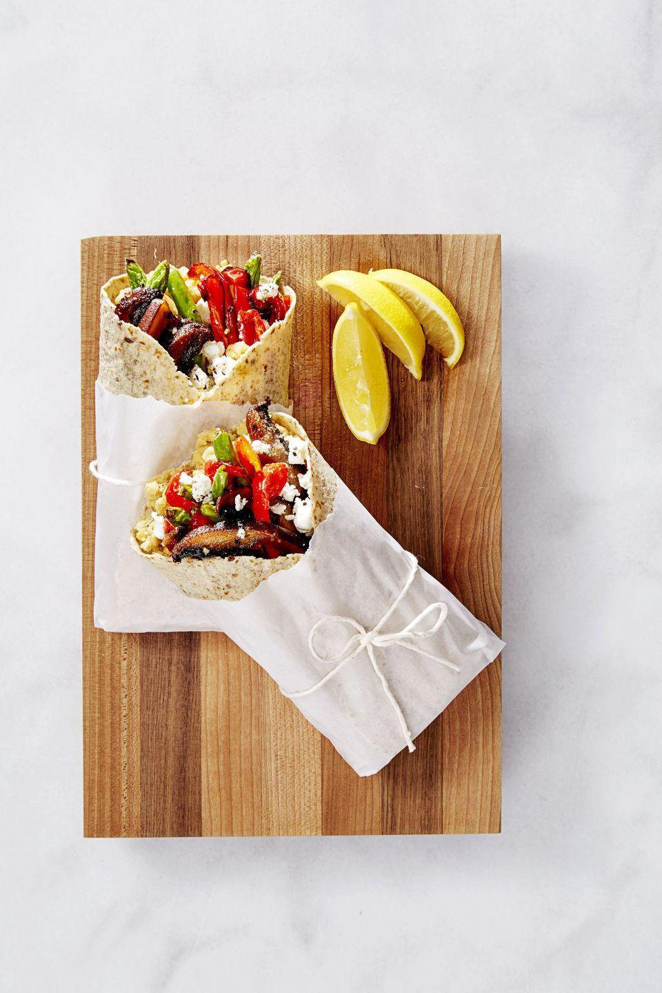 """<p>With its roasted portobellos, red peppers, green beans, and mashed chickpeas, these loaded wraps will satisfy carnivores and vegetarians alike.</p><p><em><a href=""""https://www.goodhousekeeping.com/food-recipes/easy/a36678/veggie-wraps-with-goat-cheese/"""" rel=""""nofollow noopener"""" target=""""_blank"""" data-ylk=""""slk:Get the recipe for Veggie Wraps with Goat Cheese »"""" class=""""link rapid-noclick-resp"""">Get the recipe for Veggie Wraps with Goat Cheese »</a></em></p><p><strong>RELATED: </strong><a href=""""https://www.goodhousekeeping.com/food-recipes/healthy/g2319/vegetarian-tofu-recipes/"""" rel=""""nofollow noopener"""" target=""""_blank"""" data-ylk=""""slk:38 Easy Tofu Recipes Both Vegetarians and Meat Lovers Can Get Behind"""" class=""""link rapid-noclick-resp"""">38 Easy Tofu Recipes Both Vegetarians and Meat Lovers Can Get Behind</a></p>"""