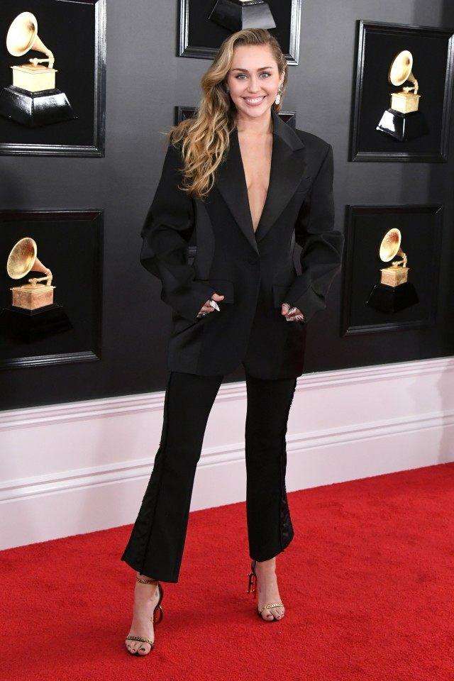 2534898cc27 Miley Cyrus Is Sleek in Sexy Black Pantsuit at 2019 GRAMMYs