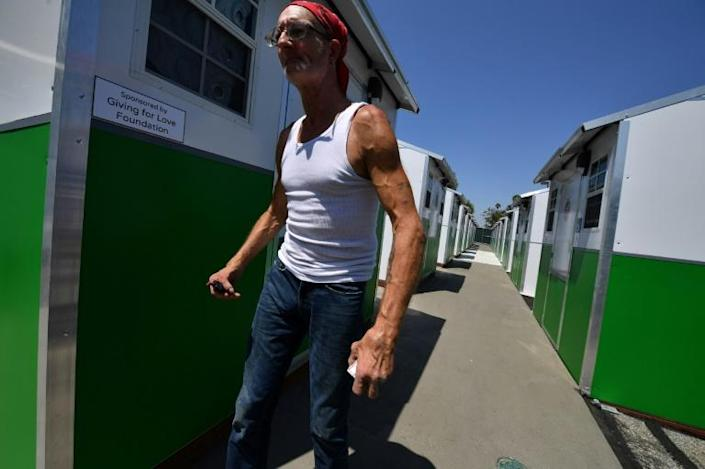 Jerome Bestul, age 62 from Wisconsin, expresses his pleasure at having a safe place to sleep and live at the Tarzana Tiny Home Village: experts however say the solution is only temporary, and the root causes of homelessness need to be addressed by the city