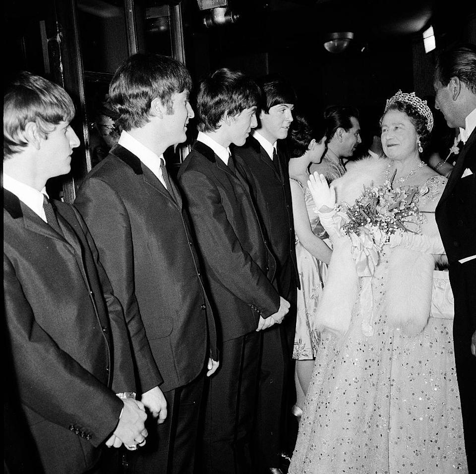 "<p>Ahead of their performance at the Royal Variety Show in 1963, The Beatles were introduced to the Queen Mother. She dazzled in a sequin embroidered ball gown, fur stole, and diamond tiara, which no doubt inspired John Lennon to <a href=""https://www.townandcountrymag.com/leisure/arts-and-culture/a10284914/beatles-royal-variety-performance/"" rel=""nofollow noopener"" target=""_blank"" data-ylk=""slk:tell the royal family"" class=""link rapid-noclick-resp"">tell the royal family</a> to ""just rattle your jewelry"" during ""Twist and Shout.""</p>"