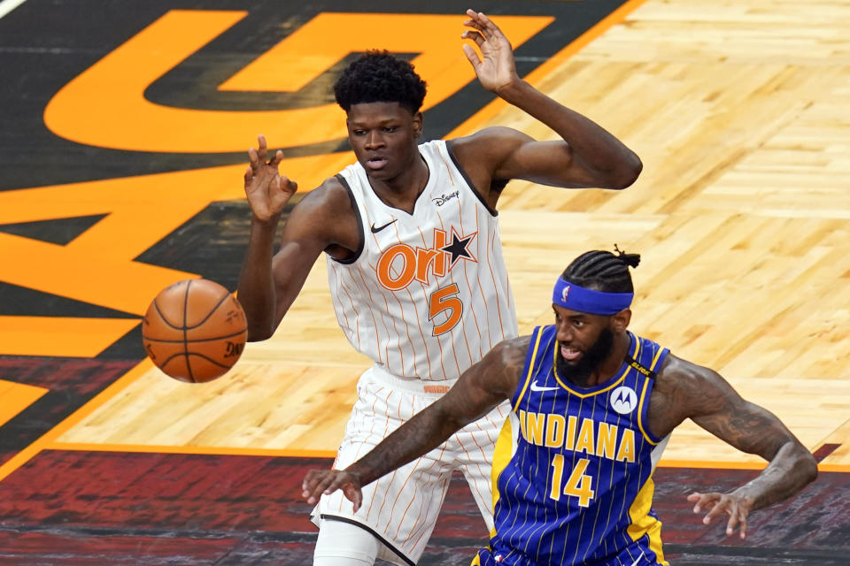 Orlando Magic center Mo Bamba (5) and Indiana Pacers forward JaKarr Sampson (14) go after a rebound during the second half of an NBA basketball game, Sunday, April 25, 2021, in Orlando, Fla. (AP Photo/John Raoux)