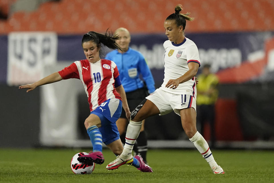 United States forward Mallory Pugh (11) and Paraguay midfielder Fanny Godoy (10) battle for the ball during the second half of an international friendly soccer match, Thursday, Sept. 16, 2021, in Cleveland. (AP Photo/Tony Dejak)