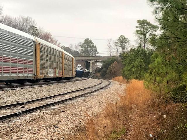 <p>A derailed Amtrak train sits on the track in Cayce, S.C., Sunday, Feb. 4, 2018. (Photo: Meg Kinnard/AP) </p>