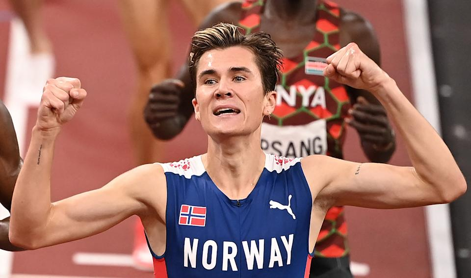 Norway's Jakob Ingebrigtsen celebrates after winning the men's 1500m final during the Tokyo 2020 Olympic Games at the Olympic Stadium in Tokyo on August 7, 2021. (Photo by Ina FASSBENDER / AFP) (Photo by INA FASSBENDER/AFP via Getty Images)