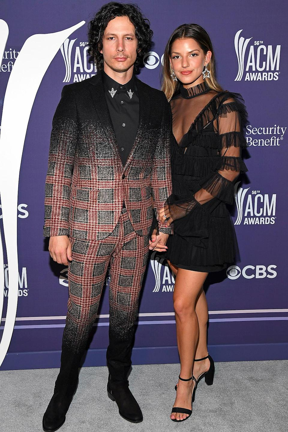 <p>The singers — who wed outside Nashville in late 2019 — brought the bold to the red carpet. </p>