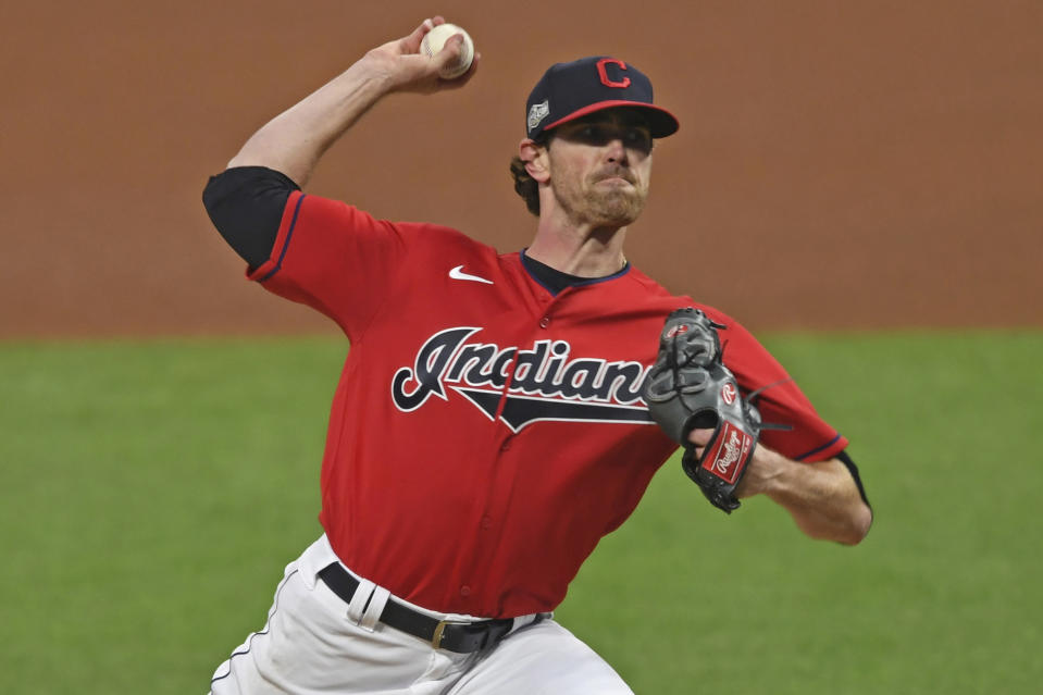 Cleveland Indians starting pitcher Shane Bieber (57) delivers in the first inning of Game 1 of an American League wild-card baseball series against the New York Yankees, Tuesday, Sept. 29, 2020, in Cleveland. (AP Photo/David Dermer)