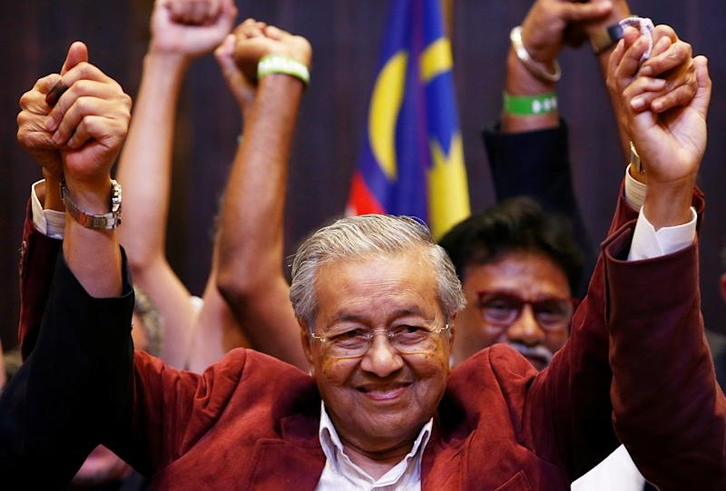 Tun Dr Mahathir Mohamad reacts after winning the May 9 polls during a news conference in Petaling Jaya May 10, 2018. — Reuters pic