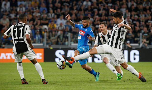 Soccer Football - Serie A - Juventus v Napoli - Allianz Stadium, Turin, Italy - April 22, 2018 Napoli's Lorenzo Insigne in action with Juventus' Sami Khedira, Stephan Lichtsteiner and Douglas Costa REUTERS/Stefano Rellandini