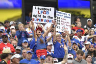 Fans cheer during the first half of an NFL football game between the Buffalo Bills and the Pittsburgh Steelers in Orchard Park, N.Y., Sunday, Sept. 12, 2021. (AP Photo/Adrian Kraus)