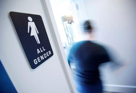 File Photo: A bathroom sign welcomes both genders at the Cacao Cinnamon coffee shop in Durham North Carolina