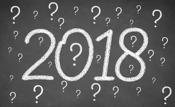 2018 on chalkboard surrounded by question marks
