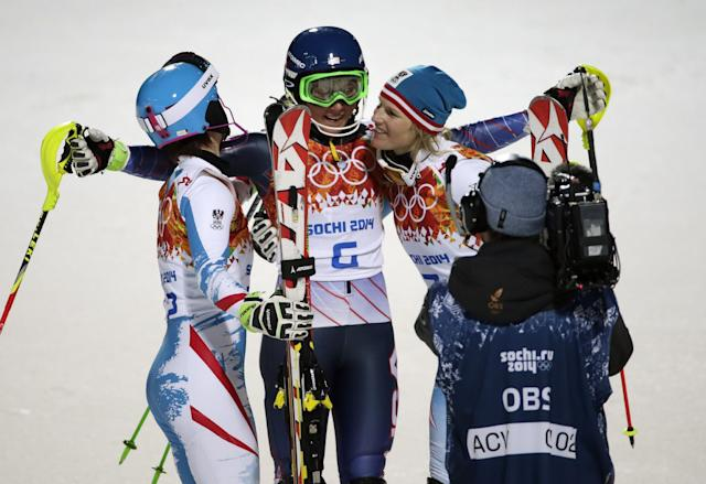 Women's slalom medalists, from left, Austria's Kathrin Zettel (bronze), United States' Mikaela Shiffrin (gold) and Marlies Schild (silver), celebrate at the Sochi 2014 Winter Olympics, Friday, Feb. 21, 2014, in Krasnaya Polyana, Russia.(AP Photo/Gero Breloer)