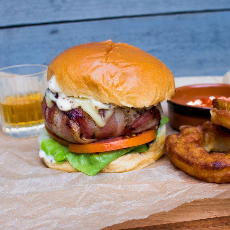 """<p>Yeah you heard it right, we've taken the classic Balmoral Chicken and turned it into <a href=""""https://www.delish.com/uk/cooking/recipes/g30993382/best-burger-recipes/"""" rel=""""nofollow noopener"""" target=""""_blank"""" data-ylk=""""slk:burger"""" class=""""link rapid-noclick-resp"""">burger</a> form because it's 2020, and we can. Balmoral Chicken is a classic Scottish dish - <a href=""""https://www.delish.com/uk/cooking/recipes/g29843799/healthy-chicken-breast-recipes/"""" rel=""""nofollow noopener"""" target=""""_blank"""" data-ylk=""""slk:chicken breast"""" class=""""link rapid-noclick-resp"""">chicken breast</a> wrapped around <a href=""""https://www.delish.com/uk/cooking/a29471155/how-to-cook-haggis/"""" rel=""""nofollow noopener"""" target=""""_blank"""" data-ylk=""""slk:haggis"""" class=""""link rapid-noclick-resp"""">haggis</a> and served alongside a punchy <a href=""""https://www.delish.com/uk/cocktails-drinks/g32488720/whisky/"""" rel=""""nofollow noopener"""" target=""""_blank"""" data-ylk=""""slk:whisky"""" class=""""link rapid-noclick-resp"""">whisky</a> sauce and it's a combination of seriously tasty flavours. </p><p>Get the <a href=""""https://www.delish.com/uk/cooking/recipes/a33820132/balmoral-chicken-burger/"""" rel=""""nofollow noopener"""" target=""""_blank"""" data-ylk=""""slk:Balmoral Chicken Burger"""" class=""""link rapid-noclick-resp"""">Balmoral Chicken Burger</a> recipe.</p>"""