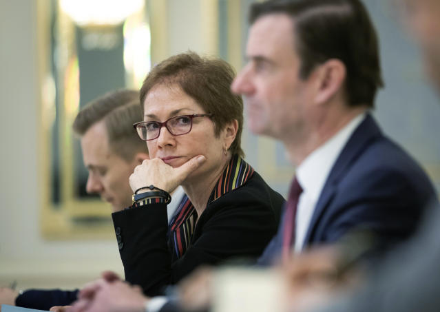 FILE - In this March 6, 2019 file photo, then U.S. Ambassador to Ukraine Marie Yovanovitch, center, sits during her meeting with Ukrainian President Petro Poroshenko in Kiev, Ukraine. Months before the call that set off an impeachment inquiry, many in the diplomatic community were alarmed by the Trump administration's abrupt removal of a career diplomat from her post as ambassador to Ukraine. The ambassador's ouster, and the political campaign against her that preceded it, are now emerging as a key sequence of events behind the whistleblower's complaint against the president. (Mikhail Palinchak, Presidential Press Service Pool Photo via AP)
