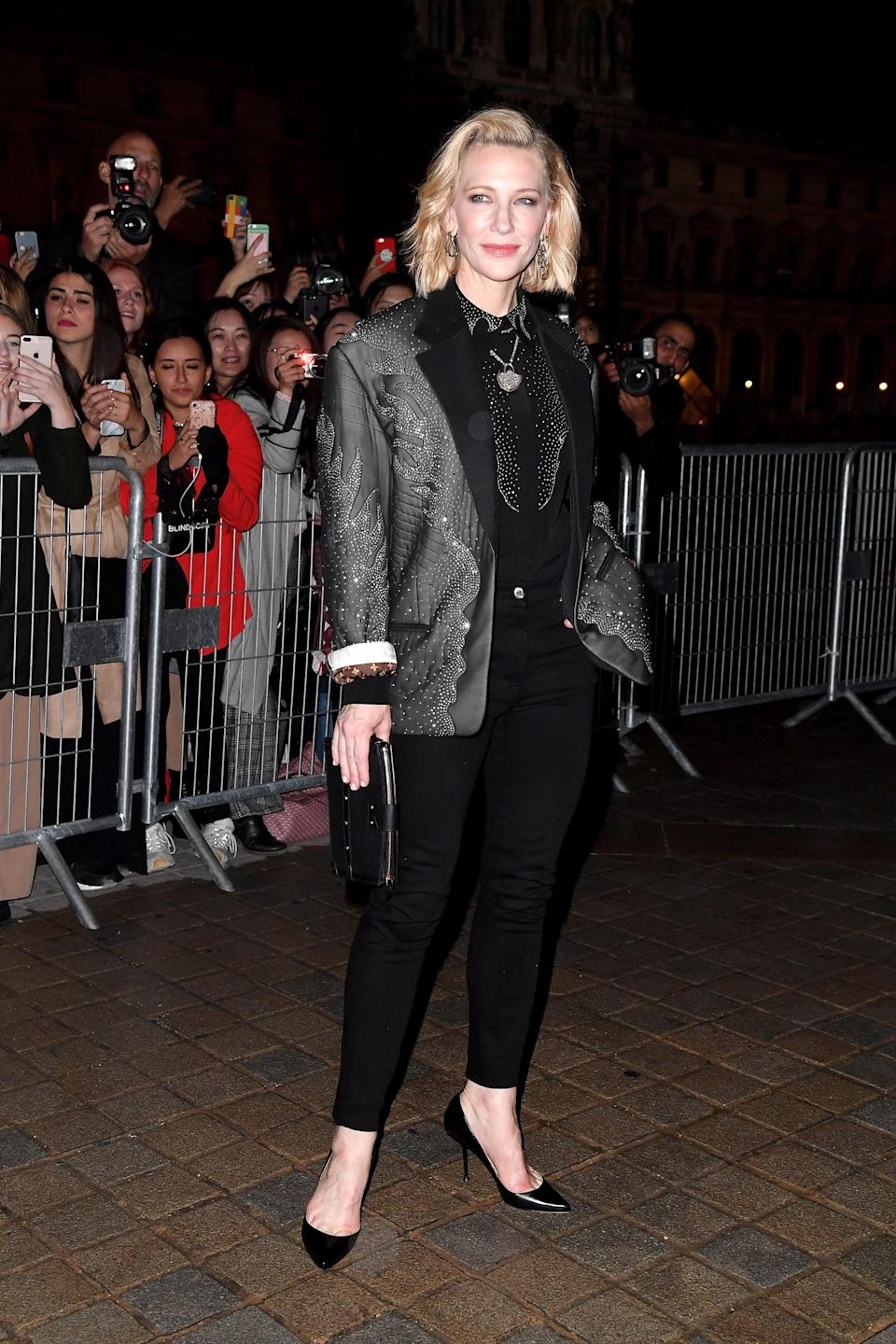 <p>Cate Blanchett gave off serious 80s vibes in an embellished black Louis Vuitton dinner jacket to the fashion house's Spring/Summer 2019 show in Paris. <em>[Photo: Getty]</em> </p>