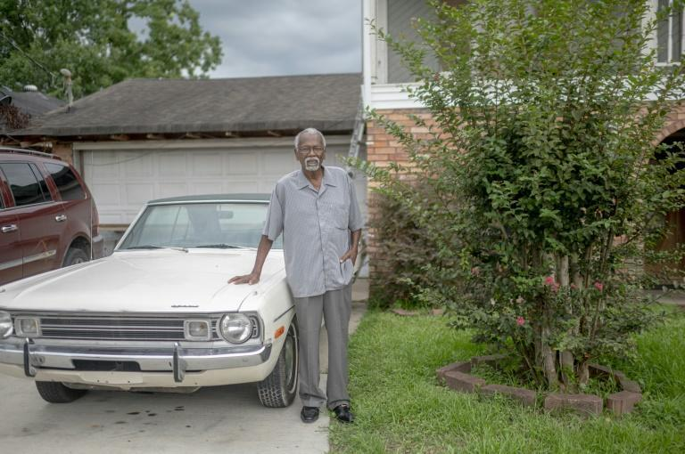 Robert Taylor, seen in front of his home in Reserve, Louisiana, has seen his mother, sister, wife and nephews all suffer from cancer