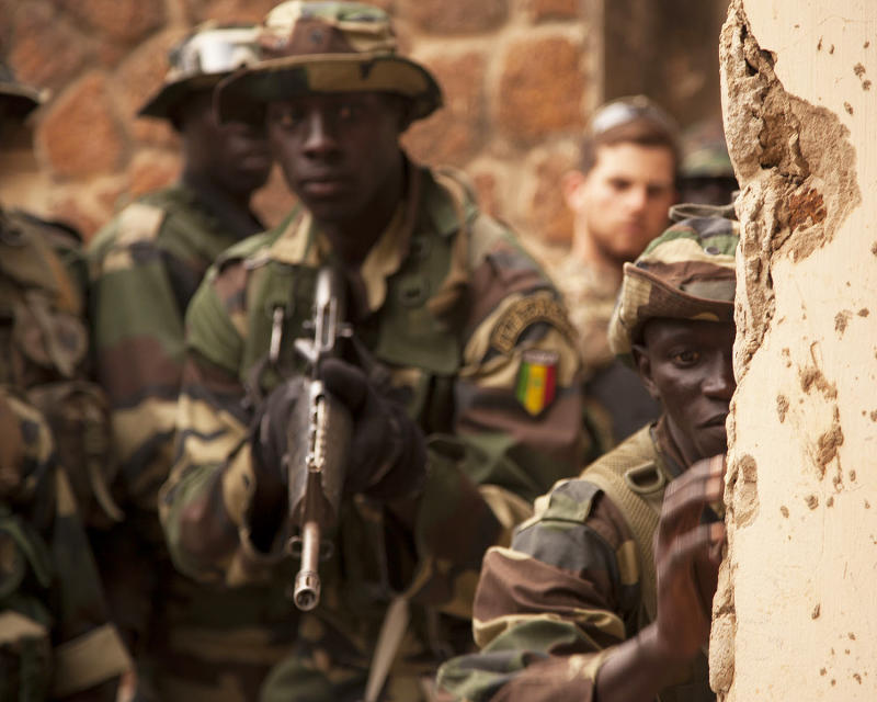 A Senegalese soldier checks for booby traps outside of a room they will clear during training near Thies, Senegal, as part of exercise Flintlock 2016.