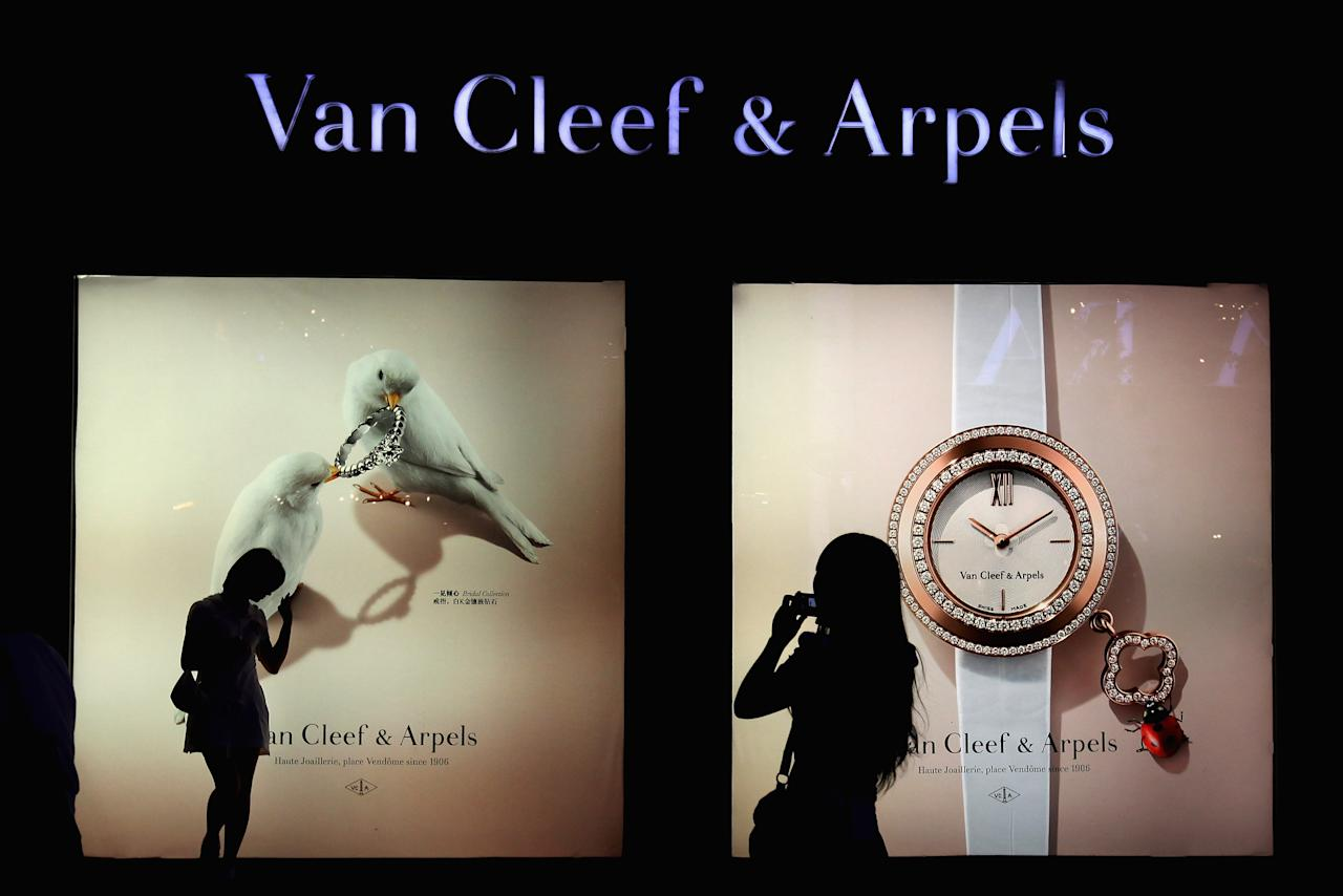 BEIJING, CHINA - JUNE 11: Chinese women walk past the Van Cleef & Arpels store on June 11, 2012 in Beijing, China. According to the World Luxury Association 2011 annual official report , China is expected to replace Japan as the world's top consumer of luxury goods by 2012 with an expected luxury goods sales value of 14.6 billion U.S. dollars due to China's growing demand and declining consumption in Japan.  (Photo by Feng Li/Getty Images)