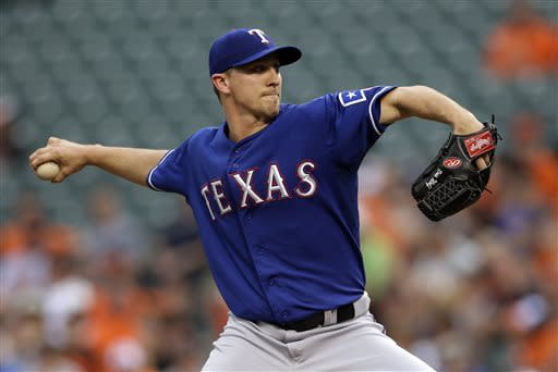 Texas Rangers relief pitcher Ross Wolf throws to the Baltimore Orioles in the first inning of a baseball game, Thursday, July 11, 2013, in Baltimore. (AP Photo/Patrick Semansky)