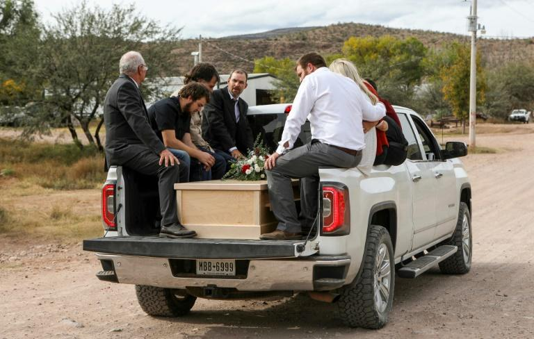 Relatives transport coffins with the remains of Dawna Langford and two of her sons; they were part of a group of nine Mormons, all with dual US-Mexican citizenship, killed in an attack in northern Mexico blamed by authorities on a drug cartel (AFP Photo/HERIKA MARTINEZ)