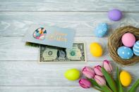 """<p><strong>ToothFairyDollarBill</strong></p><p>etsy.com</p><p><strong>$6.95</strong></p><p><a href=""""https://go.redirectingat.com?id=74968X1596630&url=https%3A%2F%2Fwww.etsy.com%2Flisting%2F761890796%2Fthe-official-easter-bunny-dollar-bill&sref=https%3A%2F%2Fwww.oprahdaily.com%2Flife%2Fg35448928%2Feaster-basket-gifts%2F"""" rel=""""nofollow noopener"""" target=""""_blank"""" data-ylk=""""slk:SHOP NOW"""" class=""""link rapid-noclick-resp"""">SHOP NOW</a></p><p>Here's a hoppy surprise for your everyone's Easter baskets: real dollar bills outfitted with a portrait of the Easter bunny himself. </p>"""