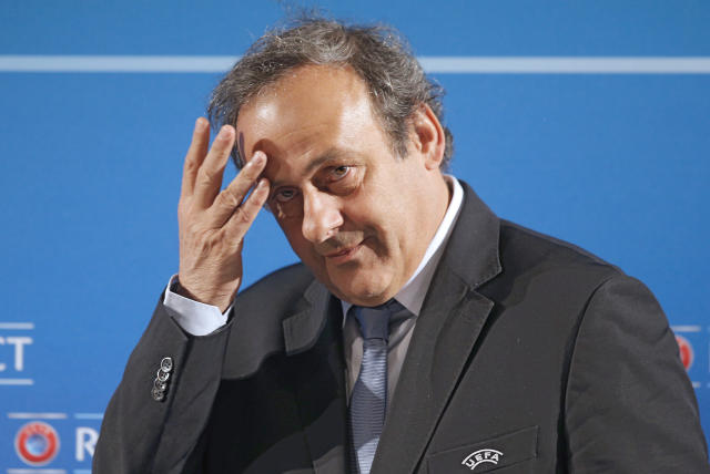 "FILE - In this Feb.22, 2014 file photo, UEFA President Michel Platini arrives at a press conference, one day prior to the UEFA EURO 2016 qualifying draw in Nice, southeastern France. Banned former UEFA President and FIFA vice president Michel Platini says he is planning to return to soccer after Swiss federal prosecutors confirmed he was not being charged in an investigation into possible financial wrongdoing it was reported on Saturday, May 26, 2018. Since September 2015 Platini had the status of ""between a witness and an accused person"" in criminal proceedings opened against then-FIFA President Sepp Blatter. (AP Photo/Lionel Cironneau, File)"
