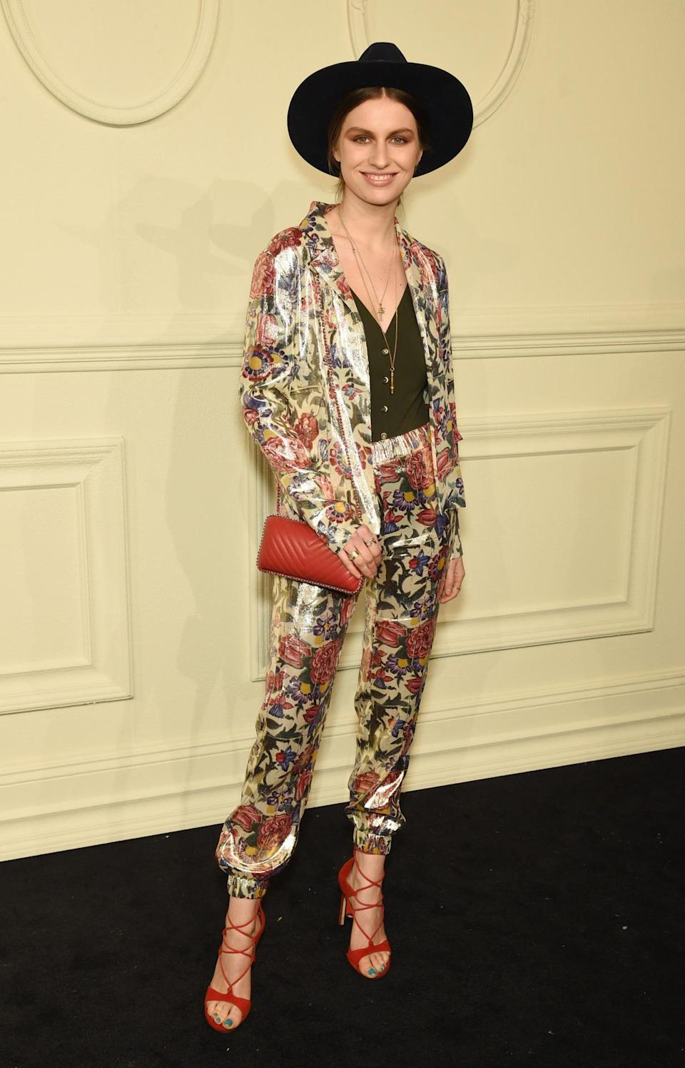 <p>Artist and model Tali Lennox poses in a printed suit with black tank and hat.</p>