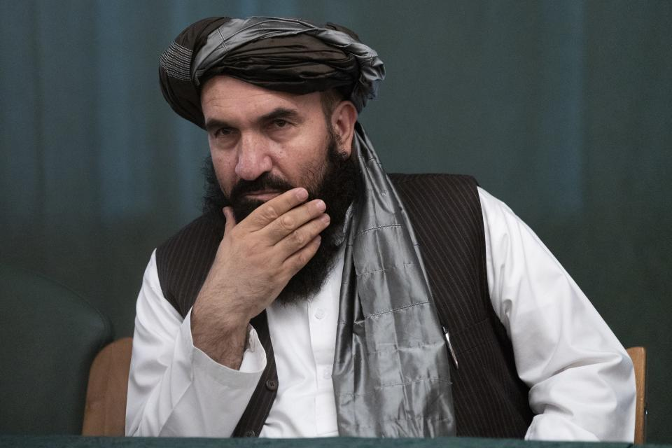 """Khairullah Khairkhwa, former western Herat Governor and one of five Taliban released from the U.S. prison on Guantanamo Bay in exchange for U.S. soldier Bowe Bergdahl, listens during a joint news conference in Moscow, Russia, Friday, March 19, 2021. The Taliban warned Washington against defying a May 1 deadline for the withdrawal of American and NATO troops from Afghanistan promising a """"reaction"""". (AP Photo/Alexander Zemlianichenko, Pool)"""