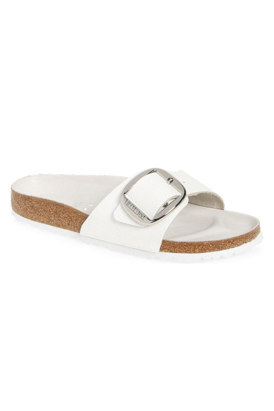 """<p><strong>Birkenstock</strong></p><p>nordstrom.com</p><p><strong>$129.95</strong></p><p><a href=""""https://go.redirectingat.com?id=74968X1596630&url=https%3A%2F%2Fwww.nordstrom.com%2Fs%2Fbirkenstock-madrid-big-buckle-slide-sandal-women%2F5759526&sref=https%3A%2F%2Fwww.marieclaire.com%2Ffashion%2Fg27205502%2Fcomfortable-walking-sandals-women%2F"""" rel=""""nofollow noopener"""" target=""""_blank"""" data-ylk=""""slk:SHOP IT"""" class=""""link rapid-noclick-resp"""">SHOP IT</a></p><p>For a sandal that you can just slip into and go on your merry way, try this white option from Birkenstock. The oversized buckle adds major fashion points to this comfortable shoe. </p>"""